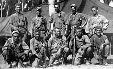 Members of Rounsaville & Nellist Teams following the successful liberation of Cabanatuan POW camp. Luzon, PI. February 1945.